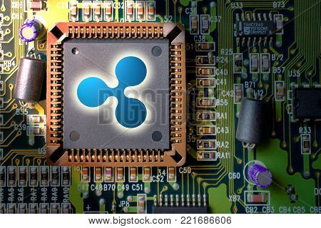 Virtual cryptocurrency and blockchain - financial technology and internet money - circuit board mining and coin Ripple XRP