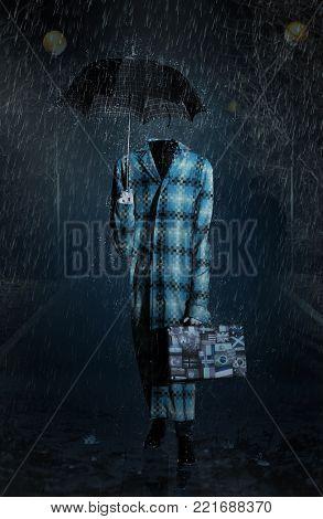Invisible man with umbrella go in the heavy rain
