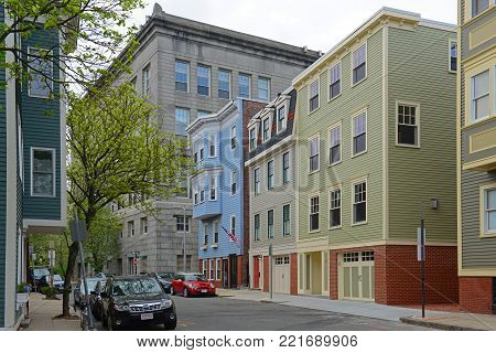 BOSTON - MAY 13, 2014: Historic Buildings on Bartlett Street at Cedar Street in Charlestown, Boston, Massachusetts, USA.