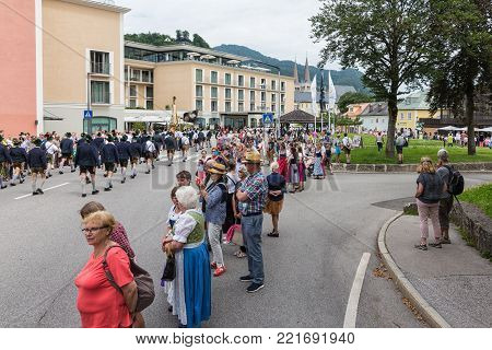 BERCHTESGADEN, GERMANY - JULY 09, 2017: Local festival with spectators parade of fanfare and people dressed in traditonal costumes. Every village from the neighbourhoud has his own costumes.