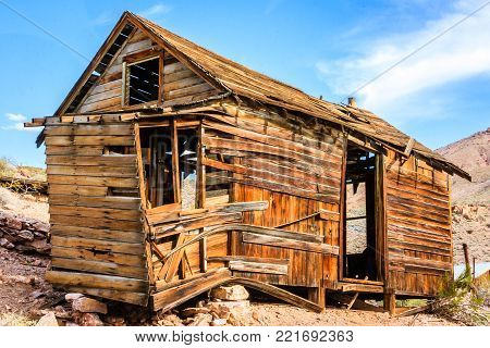A crumbling old west mining cabin located in the desert of Death Valley California
