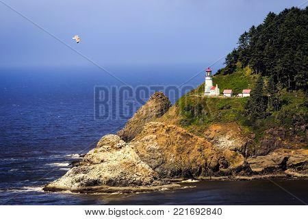 Scenic Heceta Head Lighthouse sitting on a point overlooking the Pacific Ocean near Florence Oregon