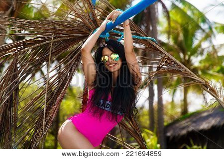 Young Beautiful Brunette Having Fun On A Tropical Beach. Summer Vacation Concept.