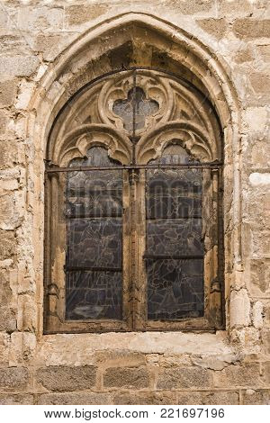 Details of old Gothic style window belonging to the cathedral of Saint Maria de Toledo. Spain