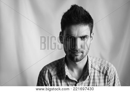 Black and white art monochrome photography. Black and white creative photography. Black and white conceptual image. Beautiful black and white background. Black and white portrait. Young attractive cheerful man with dark hair with a beard