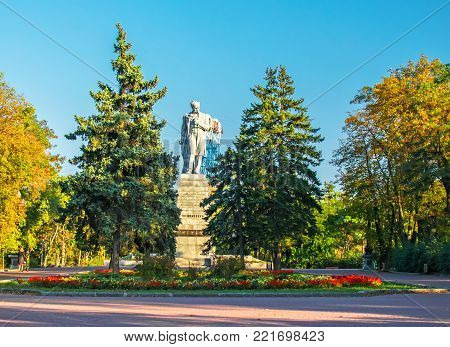 DNEPR, UKRAINE - October 2017: Autumn in city park. The highest in the world Monument known poet Shevchenko T. G.. Yellow trees, green fir-trees. Place for promenade and rest,