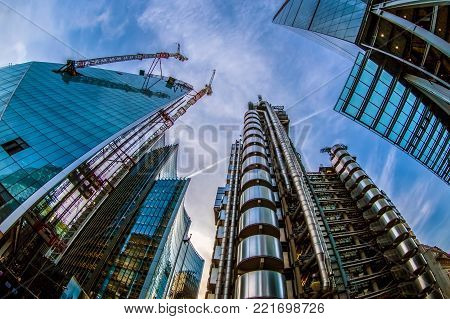 LONDON, ENGLAND - NOVEMBER 27, 2017: Wide angle shot of skyscrapers in Central London, including the Lloyd's Building (also known as The Inside-Out Building) and building in construction.
