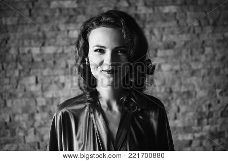 Black and white art monochrome photography. Black and white creative photography. Black and white conceptual image. Beautiful black and white background. Black and white portrait. Girl pinup with brunette hair and retro make-up