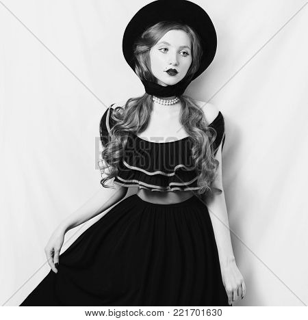 Black and white art monochrome photography. Black and white creative photography. Black and white conceptual image. Beautiful black and white background. Black and white portrait. Retro girl in a black dress on a white background.