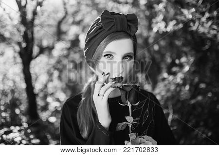 Black and white art monochrome photography. Black and white creative photography. Black and white conceptual image. Beautiful black and white background. Black and white portrait. A woman with pale skin and long hair on a summer background.