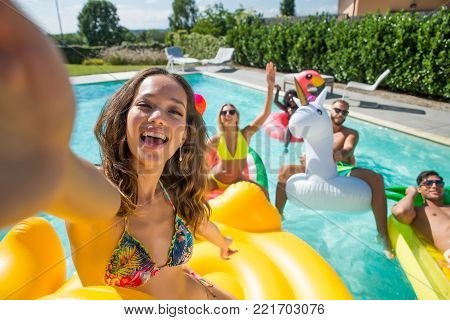 Friends Having Fun In A Swimming Pool