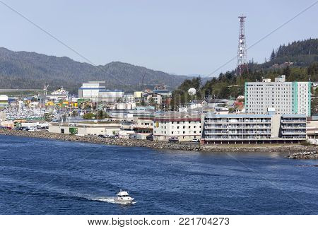 The motorboat passing by Ketchikan town waterfront (Alaska).