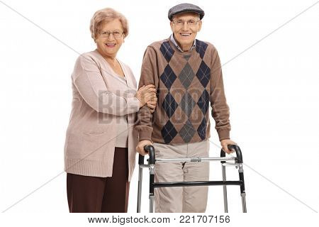 Elderly woman and an elderly man with a walker isolated on white background