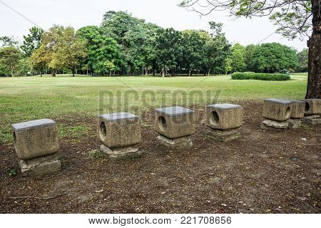 Stone chair seat in park feel free and peacefully, Bangkok Thailand