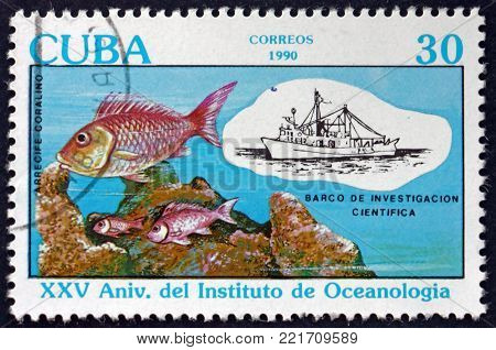 CUBA - CIRCA 1990: a stamp printed in Cuba shows research ship, fish and coral reef, 25th anniversary of the Oceanography Institute, circa 1990