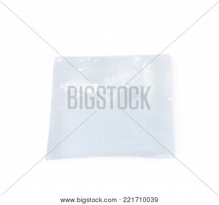 Handmade semi-transparent bar of soap isolated over the white background