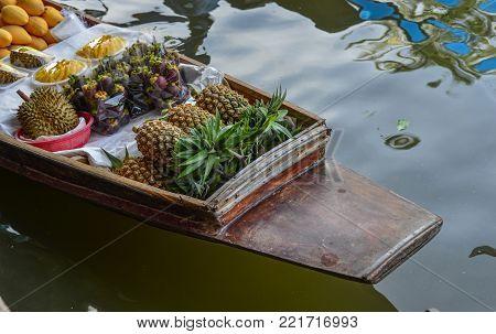 Fruits on boat at Damnoen Saduak Floating Market in Bangkok, Thailand.