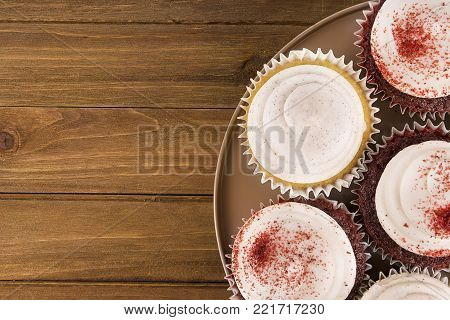 Cooking cupcakes background with on wooden table. View from above.