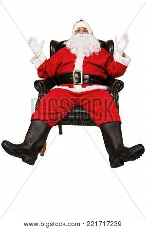 Surprised Santa Claus. Sit in chair, isolated on white background.
