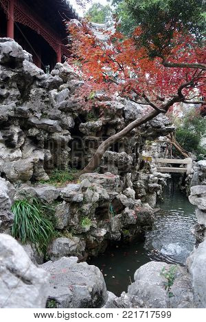 In Yu Yuan (Yu Garden)in Shanghai, China. Yuyuan Garden is a famous classical garden that was finished in 1577 by a government officer of the Ming Dynasty poster