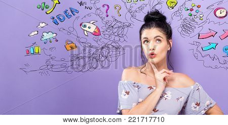 Young woman with many thoughts on a purple background