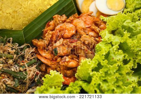 close up portrait of indonesian dish oseng tempe udang on nasi tumpeng