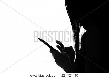 Asian Women Looking At The Smartphone Silhouetted.