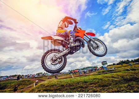 Dirtbike. Dirt bike extreme jump on motocross sunset