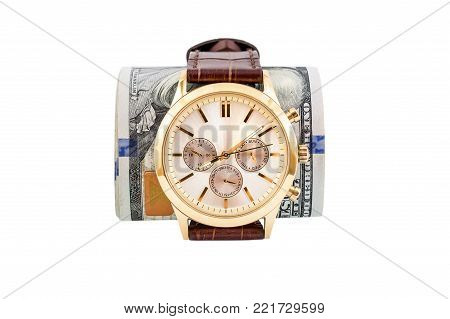 Golden Wrist watch with rolled up dollars isolated on a white.