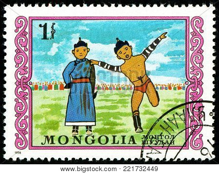 Ukraine - circa 2018: A postage stamp printed in Mongolia shows Mongolian wrestling. Series: International Childrens Day. Circa 1976.