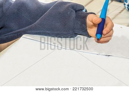 Left handed young working on his homework - copy space