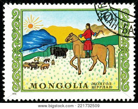 Ukraine - circa 2018: A postage stamp printed in Mongolia shows Herding. A shepherd is looking after a herd of sheep on horseback. Series: International Childrens Day. Circa 1976.