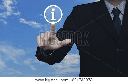 Businessman pressing information sign icon over blue sky with white clouds, Contact us concept