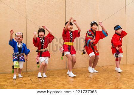 Hokkaido, Japan - 28 December 2017 - Japanese local kids performers in traditional Japanese dress perform traditional local Japanese style dance for hotel guests at Eclipse hotel in Hokkaido, Japan on December 28, 2017