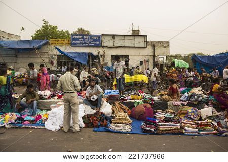 DELHI, INDIA - December 13 2014 :  evening scene of people at Meena Bazar marketplace near jama masjid in old delhi.
