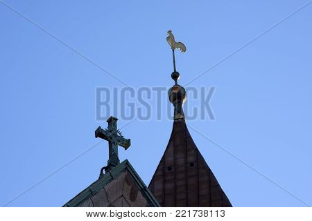 Cathedral tower and spire close-up and sky blue in Ribe, Denmark.