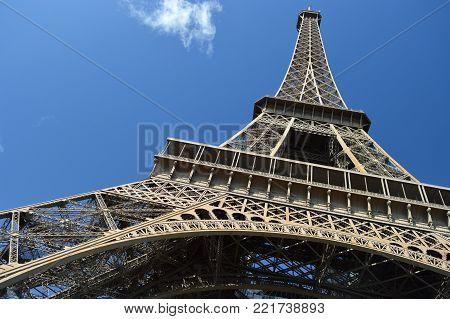 Eiffel Tower, Paris against a blue sky.