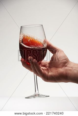 Red wine with sparkle in glass isolated on white background. Close-up of red wine with bubble