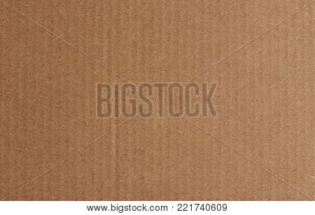 Close-up of brown cardboard paper texture. Flat box carton paper design background
