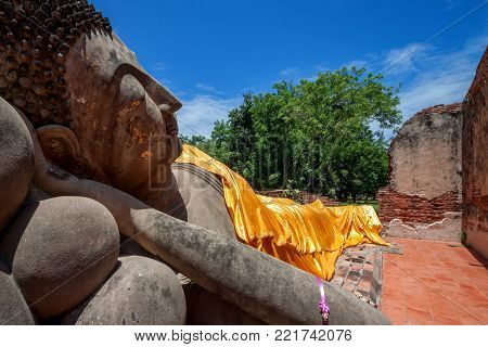 Reclining buddha statue in Wat Phutthaisawan, The ancient temple in Ayutthaya, Thailand