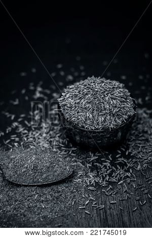 Cumin,cuminum Cyminum And Powder On Wooden Surface.