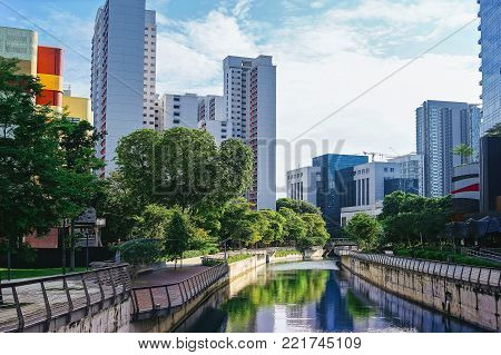 Water channel in the green city . Beautiful view of the city.
