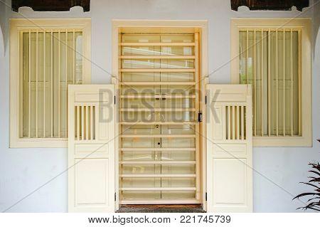 Street beige door. The front door. Double doors
