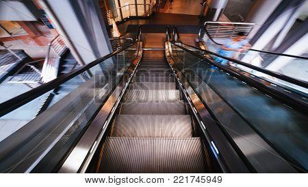 diminishing moving escalator in office center. Escalator in motion