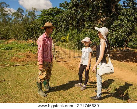 Vinales, Cuba - December 5, 2017: Cuban peasant talks with the tourists in the Vinales Valley (Cuba)