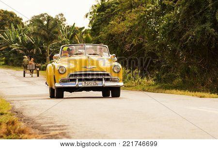Vinales, Cuba - December 6, 2017: Classic 50s car on a street of Cuba