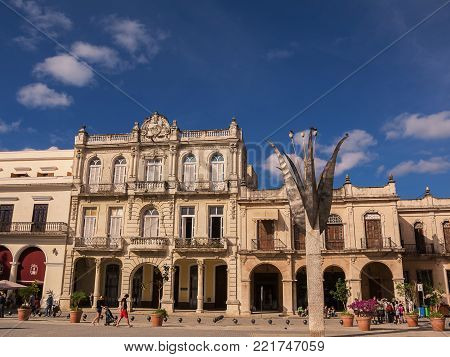 Havana, Cuba - 11 december 2017: Old square (Plaza Vieja) in Old Havana with tourists on a sunny day.