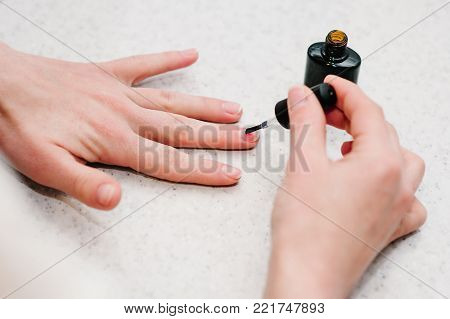 Nail primer during the procedure nail gel, Manicure arms, Good healthy nails.