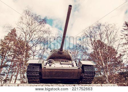 Soviet medium tank of the World war II., Kezmarok, Slovak republic. Symbolic object. Red photo filter.
