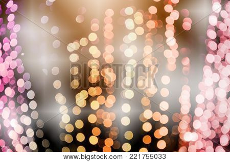 Bokeh abstract background in blue and gold color.